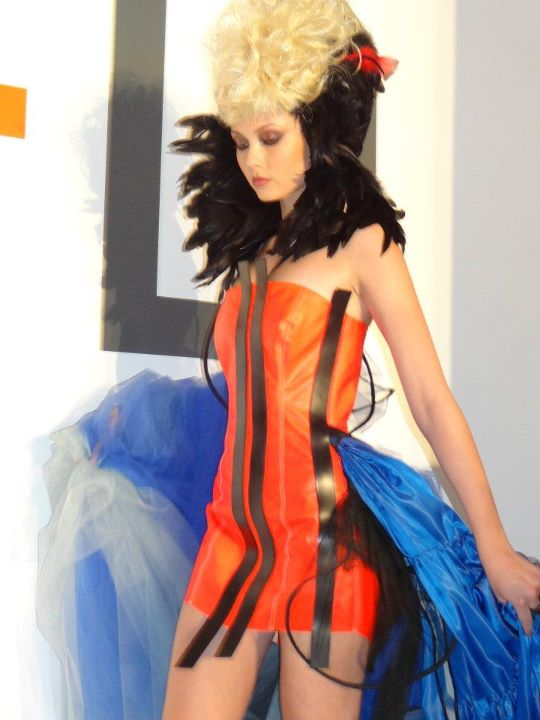 girl in orange dress with blue train