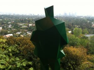 Green man looks onto LA