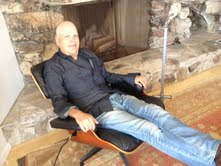 Tom Saunders in Eames chair jpg