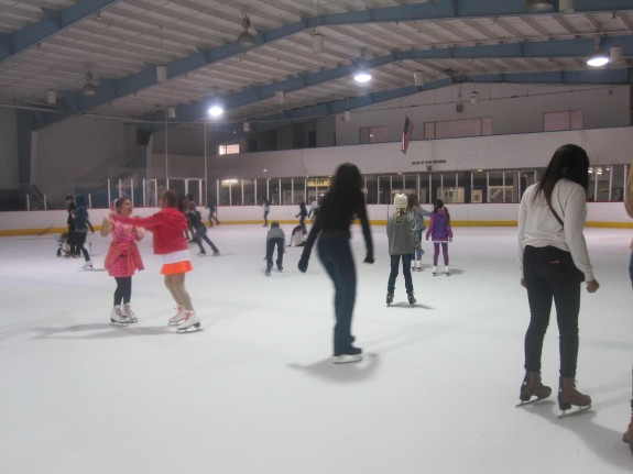 People skating, girls in pink