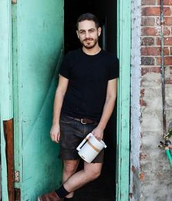 Ben Medansky at door of studio