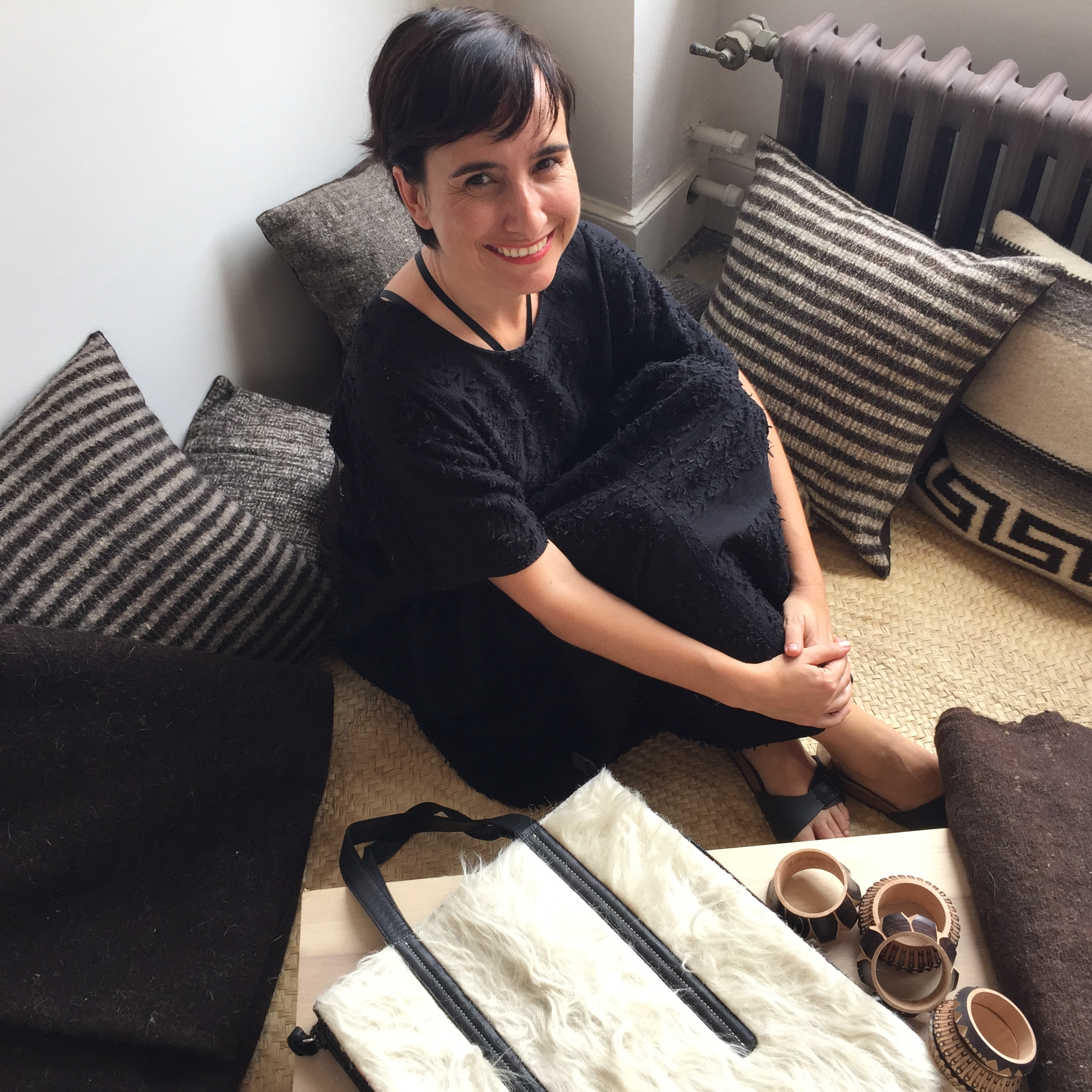 Carla Fernandez sits amidst her designs, handmade in Mexico; photo by Mallery Roberts Morgan