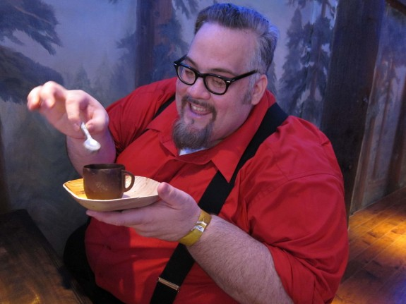 Chris Nichols enjoys butterscotch budino served in chocolate cup with edible spoon
