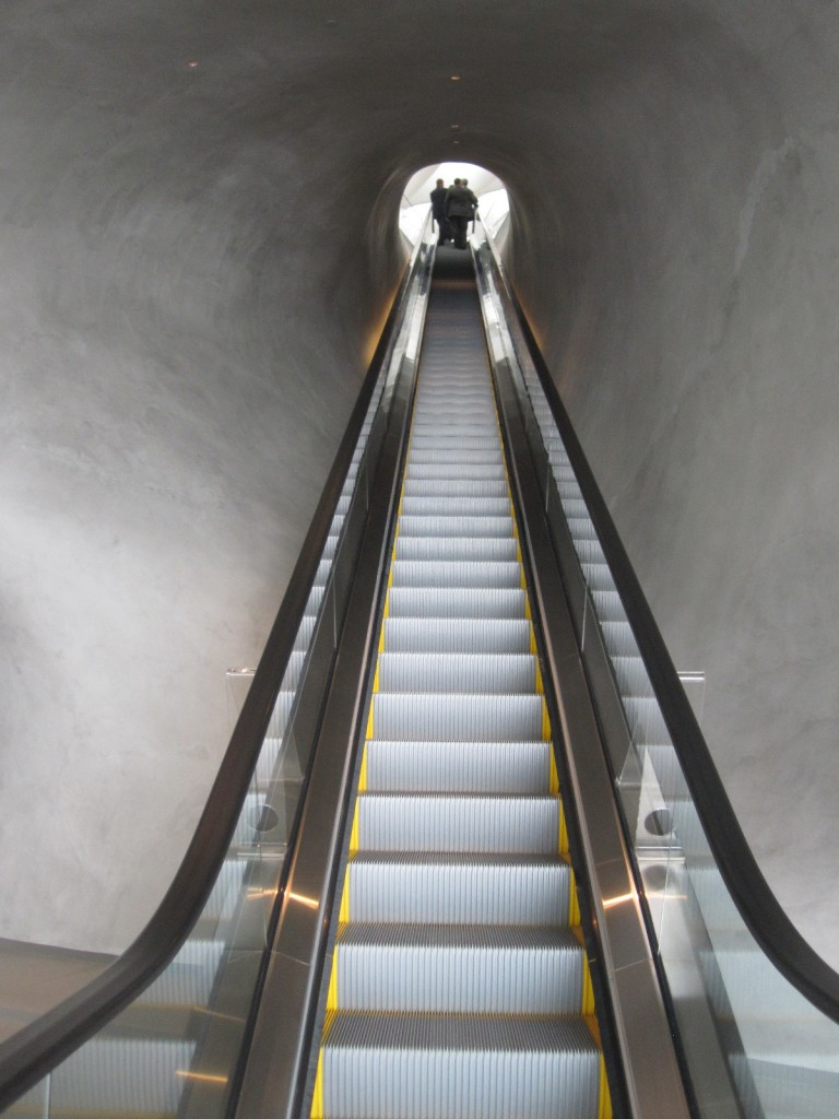 "The escalator delivering visitors to the upper level gallery space has been likened to a ""birth canal."""