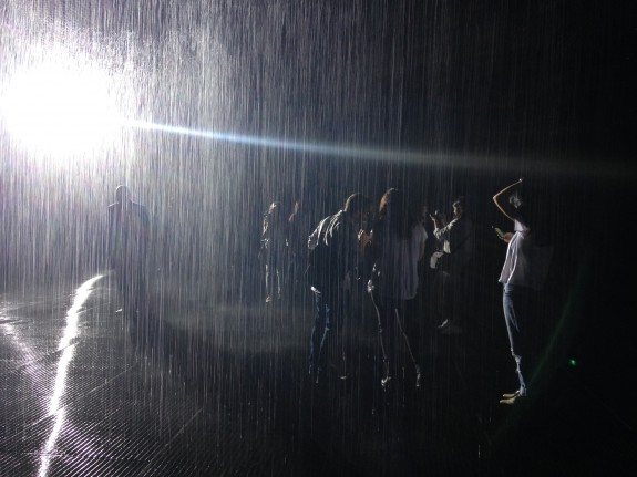 Avishay Artsy interviews people in Rain Room; only his shiny headphones get wet; photo: Frances Anderton