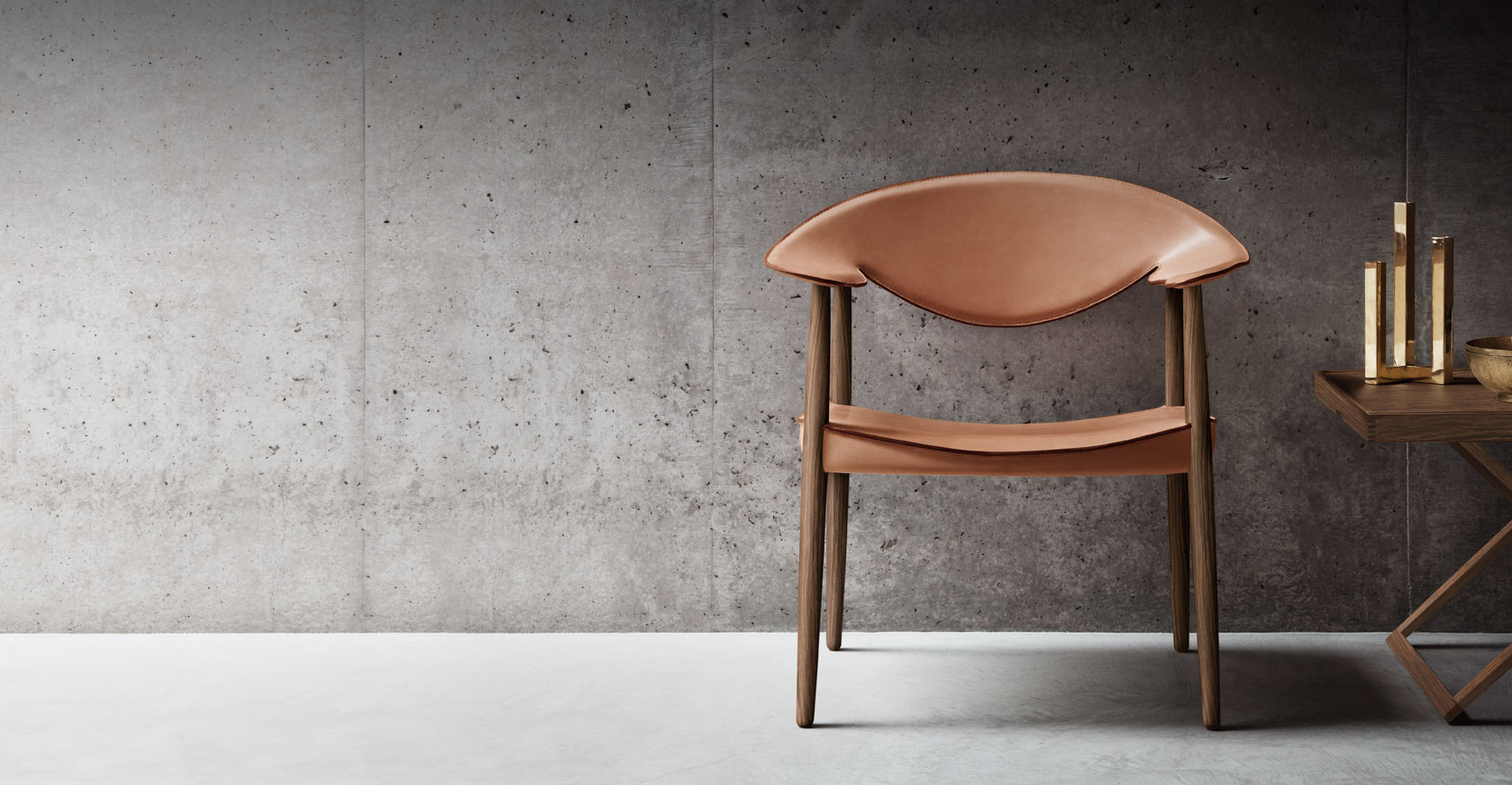 A folding table and walnut chair from Carl Hansen.