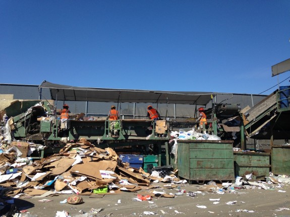 Men sorting waste