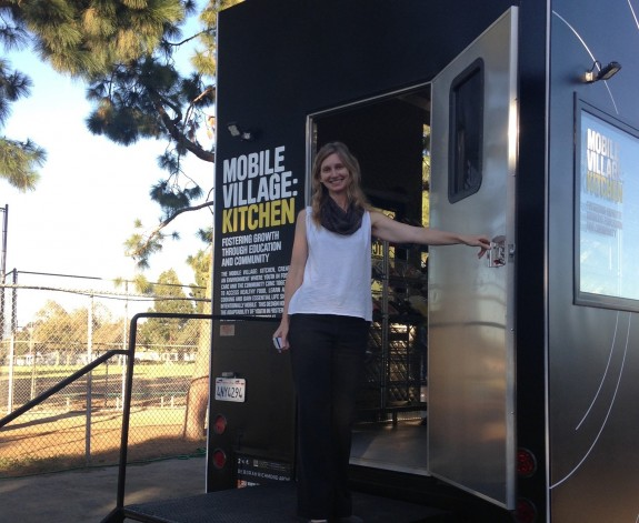 Deborah Richmond on the steps of the Mobile Village: Kitchen. Photo by Frances Anderton