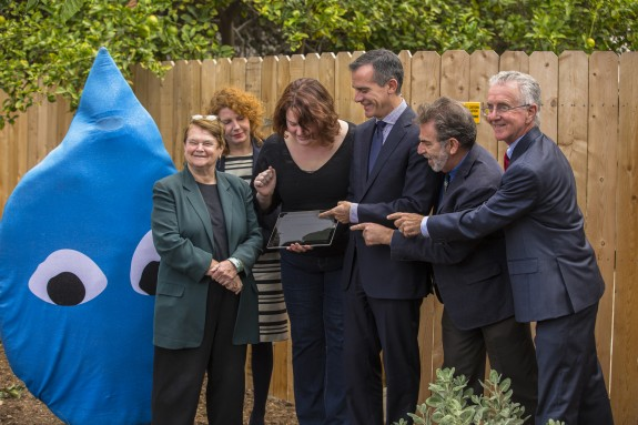 Andy Lipkis, second from right, and Mayor Eric Garcetti, center, unveil LA Storm Catcher, November 4, 2015