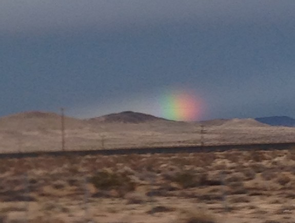 Rainbow over desert approaching Las Vegas