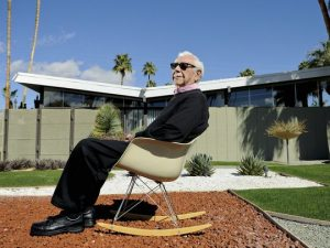 William Krisel relaxes in front of a Palm Springs home he designed. (Photo: James Schnepf/Palm Springs Modern Living)