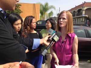 Jill Stewart talks to reporters at 8th and Catalina Streets in Koreatown. To her left are neighborhood activists Aura Vasquez and Grace Yoo. Photo by Avishay Artsy