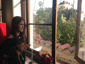 Sylvie Shain looks out her window of the Villa Carlotta in Hollywood. Photo by Avishay Artsy