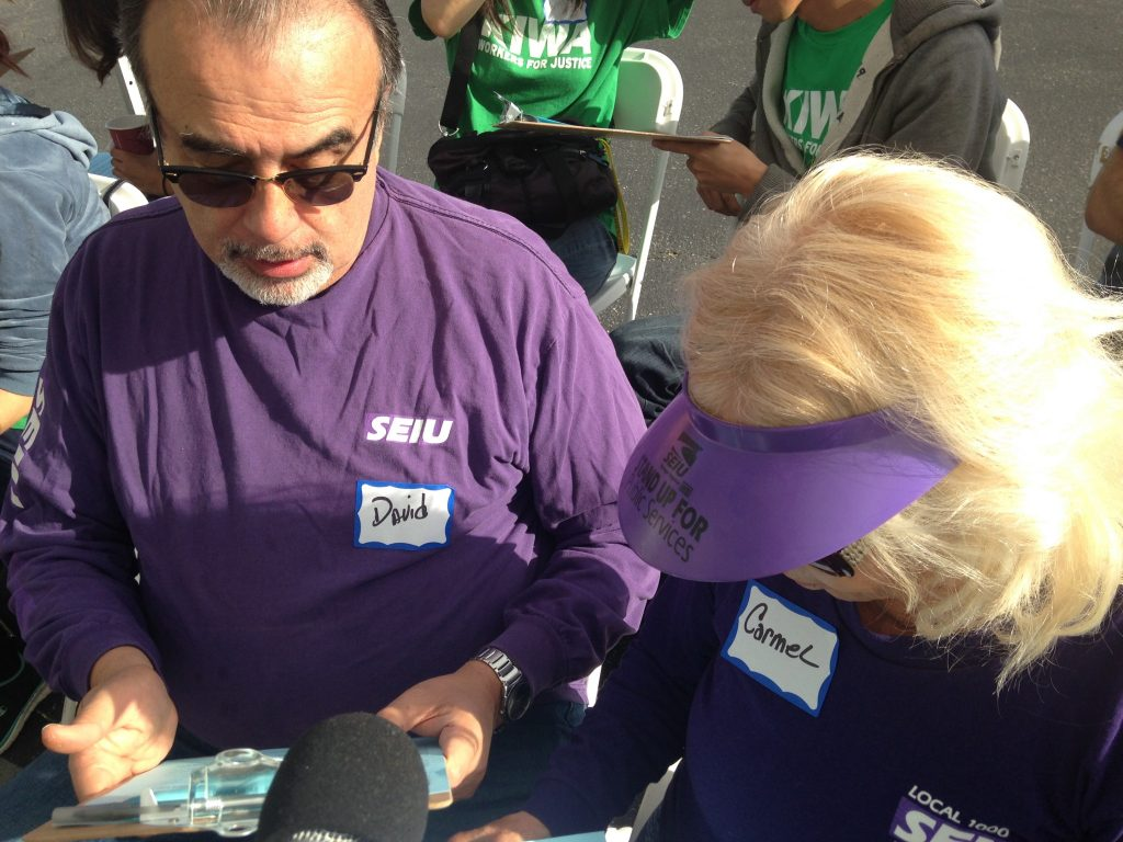 Volunteer signature gatherers practice their pitch for Build Better LA on Saturday, March 26, 2016. Photo by Avishay Artsy.