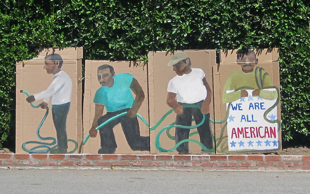Ramiro Gomez is known for his paintings and cardboard cutouts of working people who often go unacknowledged. This installation was placed outside George Clooney's home during a visit by President Obama.