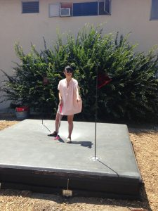 "Jia Gu on one of the minigolf obstacles, ""SiNK"" by Kyle May."