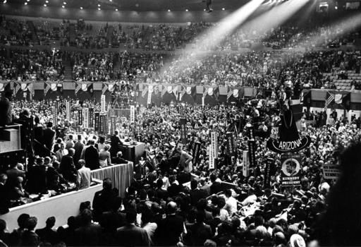 On July 14, 1960, U.S. Sen. John F. Kennedy addresses delegats in the spotlight on the rostrum during the Democratic Convention at the Los Angeles Sports Arena in Los Angeles | Courtesy of AP