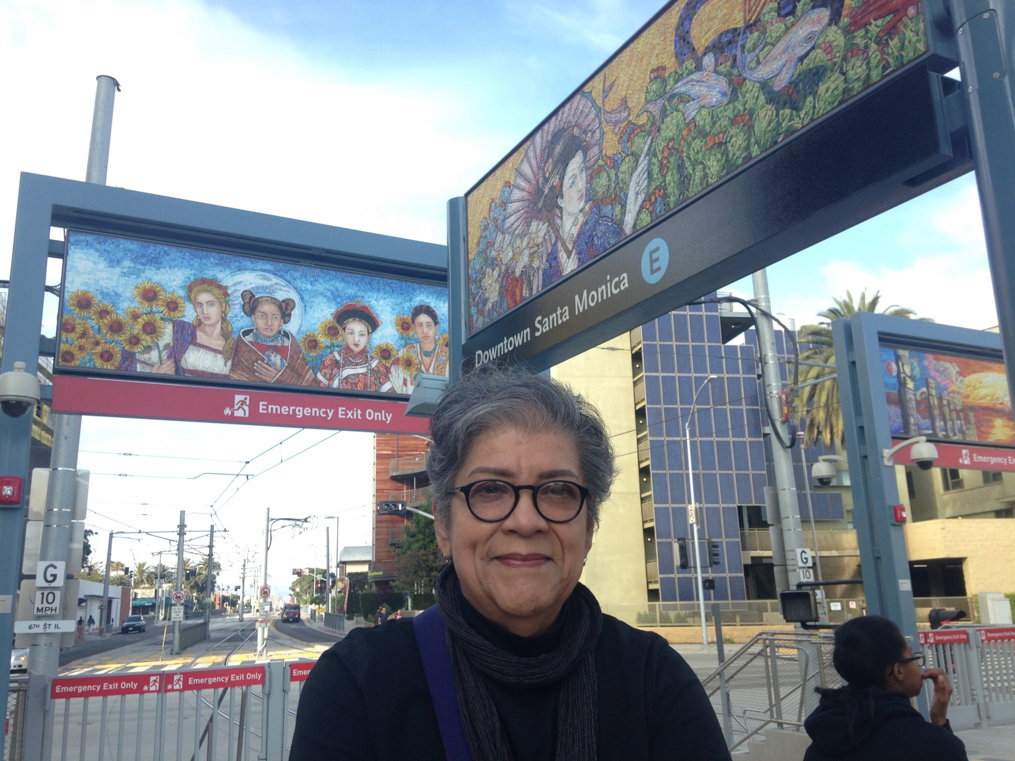 "Judithe Hernandez at the downtown Santa Monica Metro station, which features her ""LA Sonata"" artwork. Photo by Avishay Artsy."