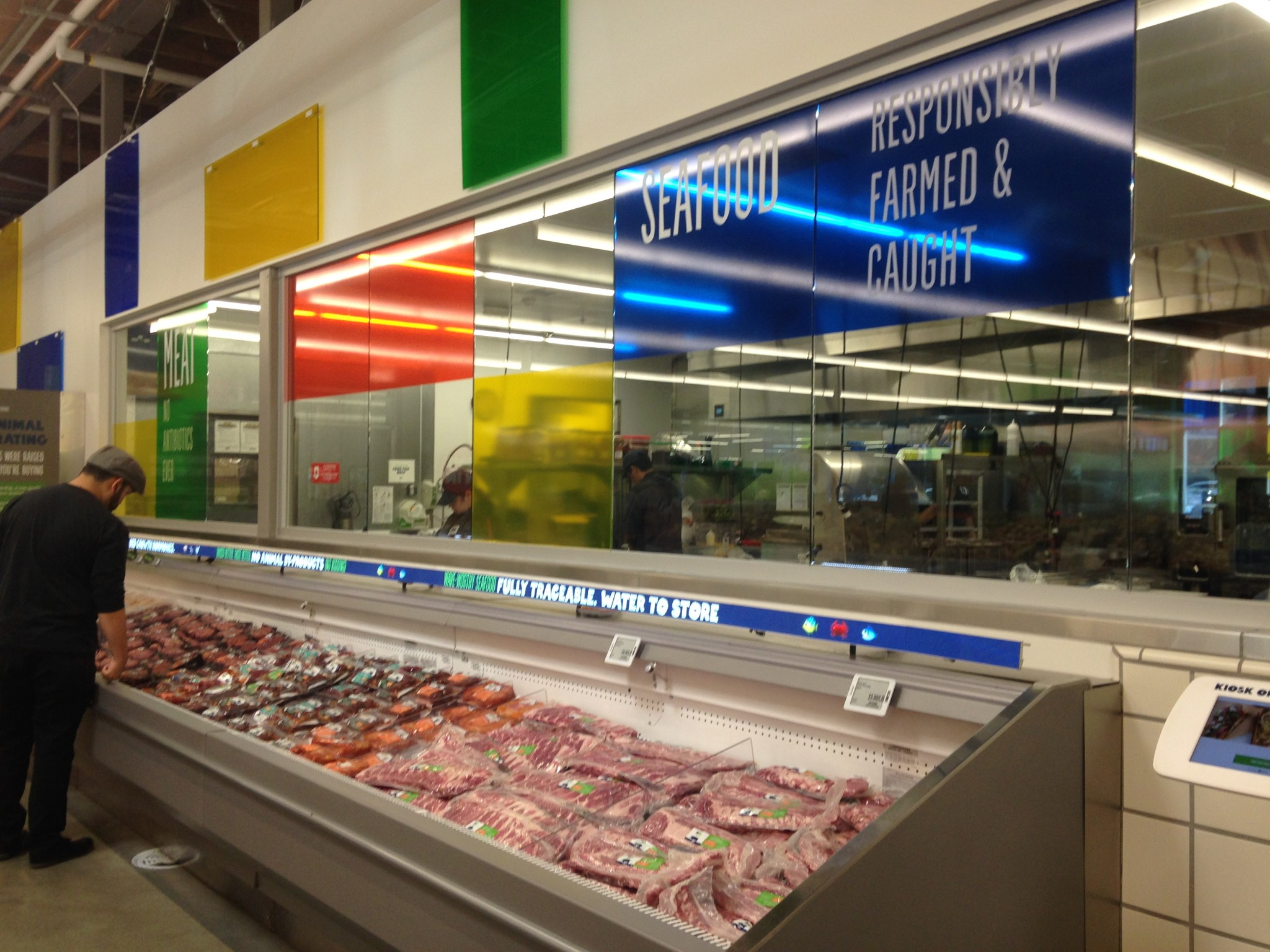 Bright colors and assuring signage at the 365 by Whole Foods Market. Photo by Avishay Artsy.