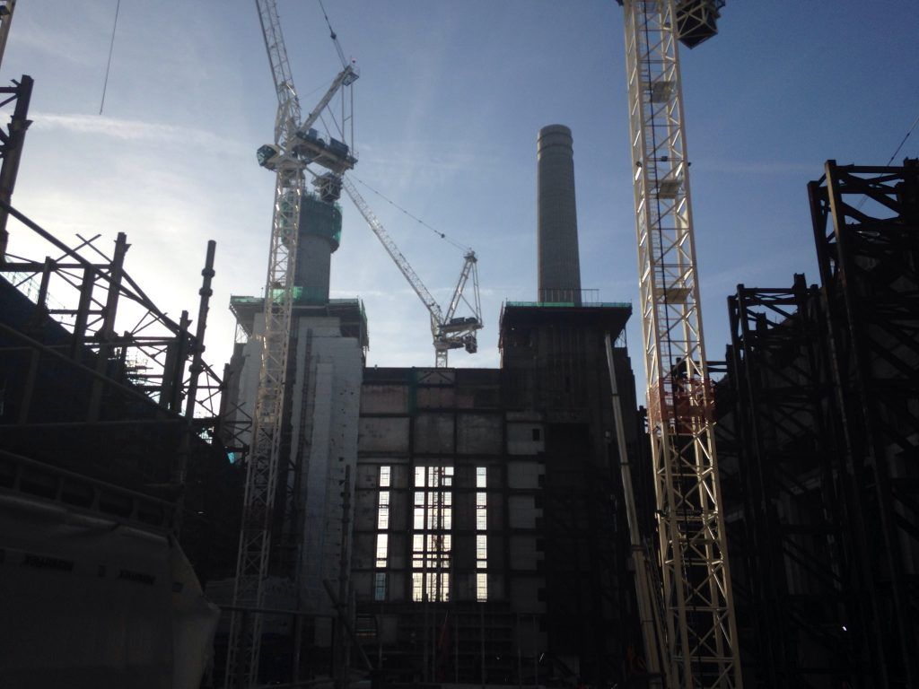 View of the towers from from inside the Battersea Power Station, currently stripped back for full restoration photo: Frances Anderton.)
