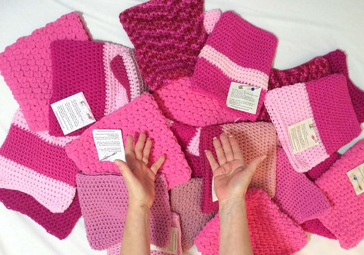 A collection of hats ready for shipping to marchers photo courtesy The Little Knittery.)