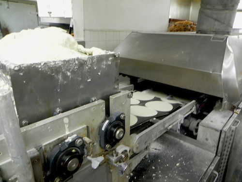 Pressing tortillas at El Toro