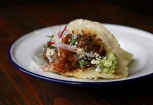LOS ANGELES, CA: January 11, 2013 - Carne Guisada puffy tacos is one of the meals offered on the menu at Bar Ama, a Tex Mex restaurant downtown. (Katie Falkenberg / Los Angeles Times)