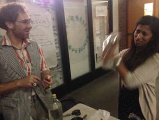 Howard Seth Cohen, left, demonstrates to Saba Mirza how to shake an egg white to create foam.