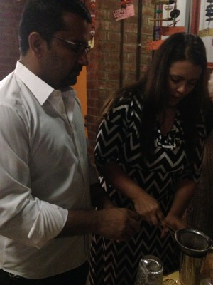 Aziza Hasan, left, and her husband Sani Abdul-Jabbar create their own non-alcoholic cocktail.