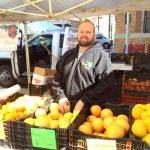 AJ Bernard organizes his baskets of fruit by sweetness