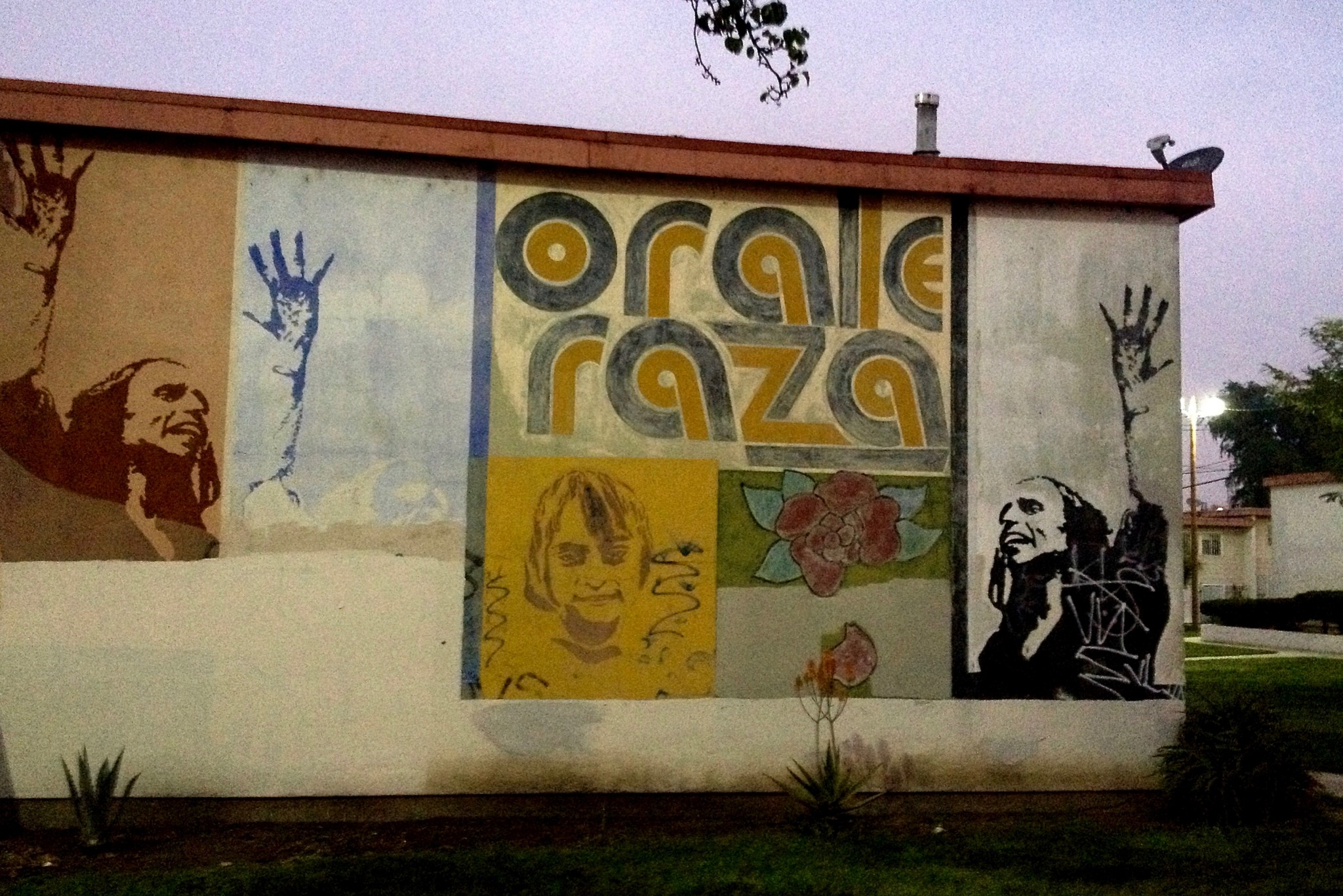We paused to check out the Estrada Courts Orale Raza mural