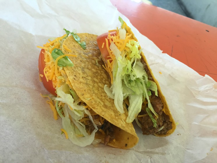 The ground beef tacos at Taco Fiesta feature thick tomatoes, shredded cheddar cheese and lettuce. <em>(Photo by Garrett Snyder)</em>