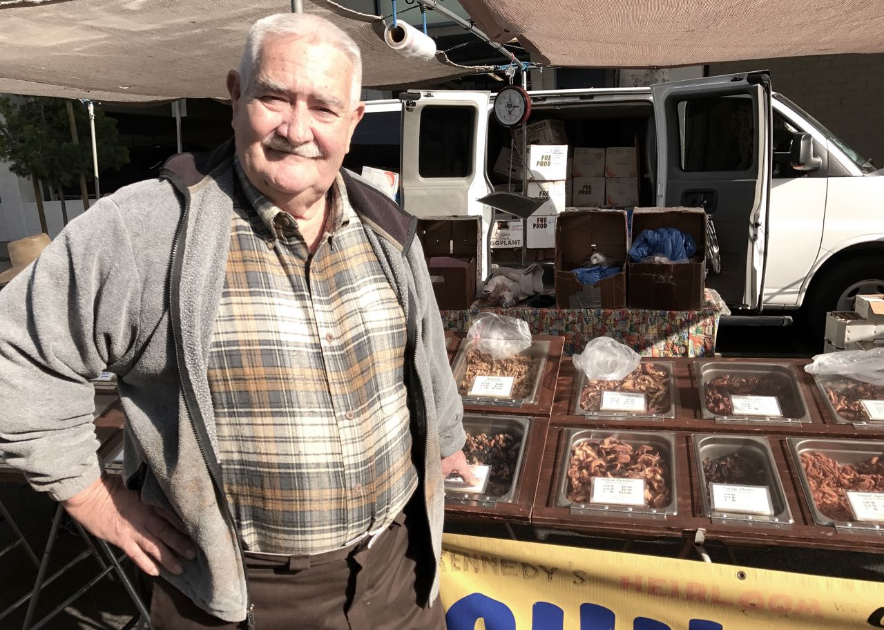 Ken Kennedy sells black and English walnuts at the Santa Monica Farmers Market. Photo by Joseph Stone/KCRW