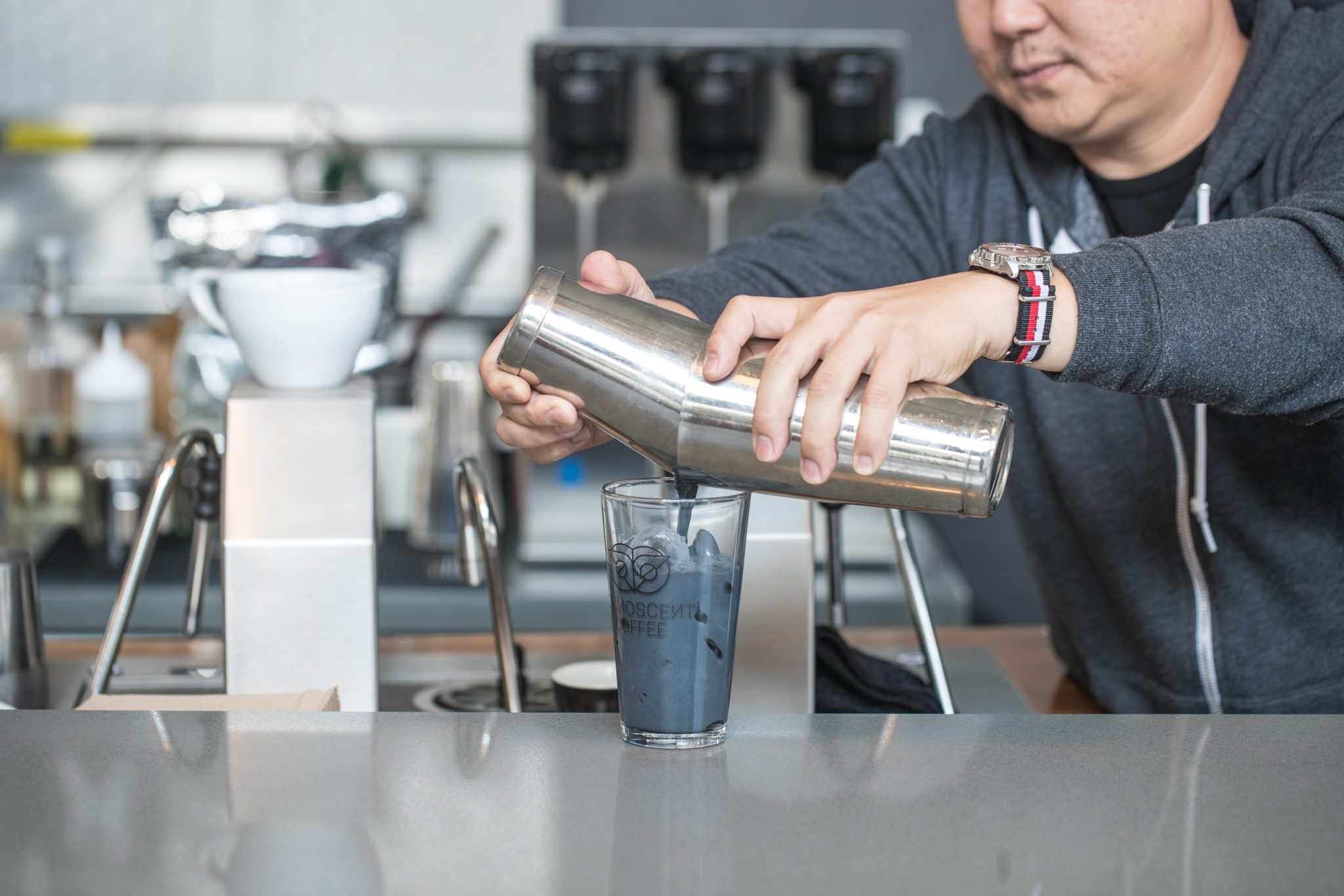 Cognoscenti Coffee owner Yeekai Lim adds one teaspoon of activated charcoal powder to each latte.