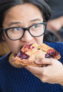 Isa Fabro digs into a piece of blackberry vanilla pie at Cassell's Hamburgers.