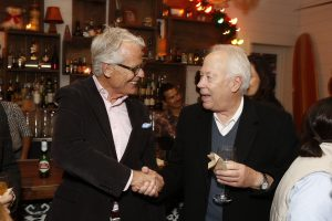 Board Member Rod Perth shaking hands with Tom Schnabel
