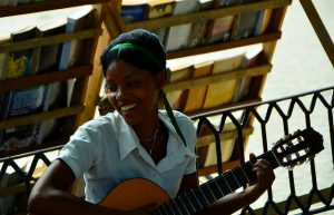Young singer and guitarist in Havana, Cuba. Photo by Bud Ellison (CC BY 2.0) via Flickr