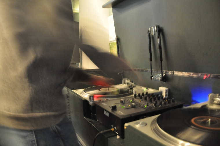 Lefto spinning on two turntables at KCRW