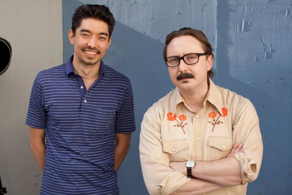 Travis and John Hodgman by Micah Cordy