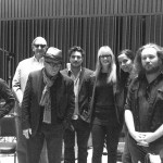 The New Basement Tapes by Paul Moore. (From L to R: Taylor Goldsmith, T Bone Burnett, Elvis Costello, Marcus Mumford, Anne Litt, Rhiannon Giddens, Jim James.)