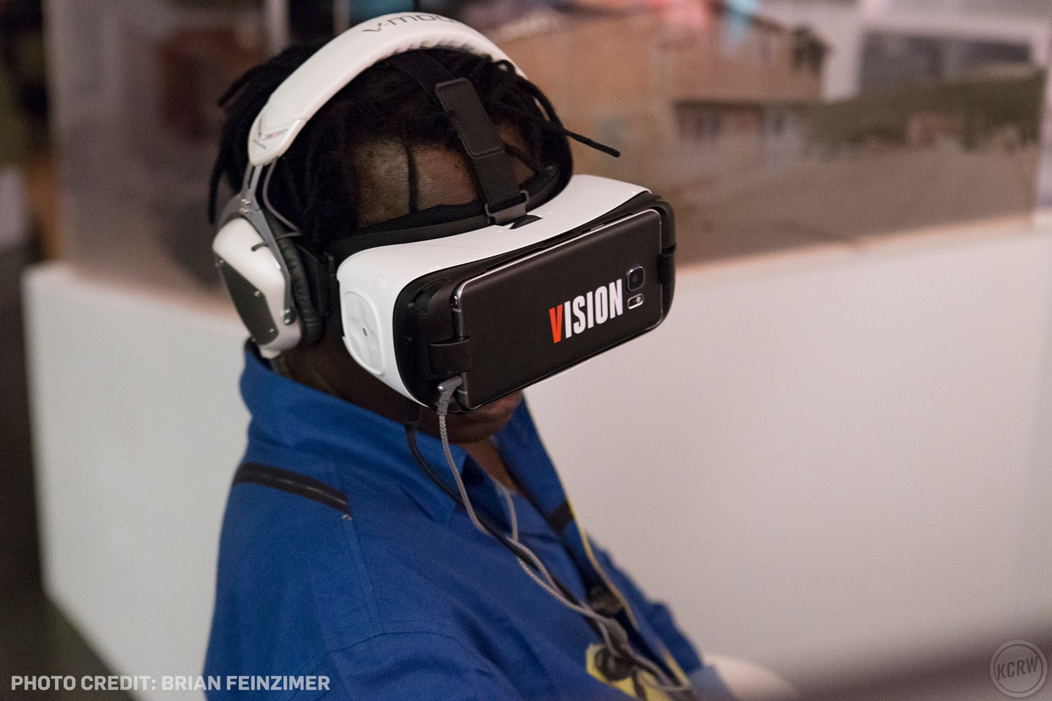 Baaba Maal tries out the VR experience in Annenberg's REFUGEE exhibit