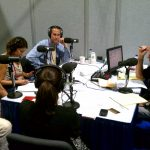 Warren Olney and a round table of guests at the RNC