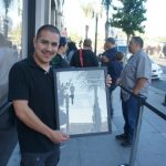Francisco Naranjo from East L.A.was first in line for an iPhone 5 at the Pasadena store. The frame he's holding is of the L.A. Times story about him the last time he was customer number one.