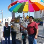 Juan Antonio Hernandez and his wife Sofia own a fruit cart usually parked near USC. They have all their permits from the Department of Public Health and don't understand why they can't legally sell their products in the City of L.A.