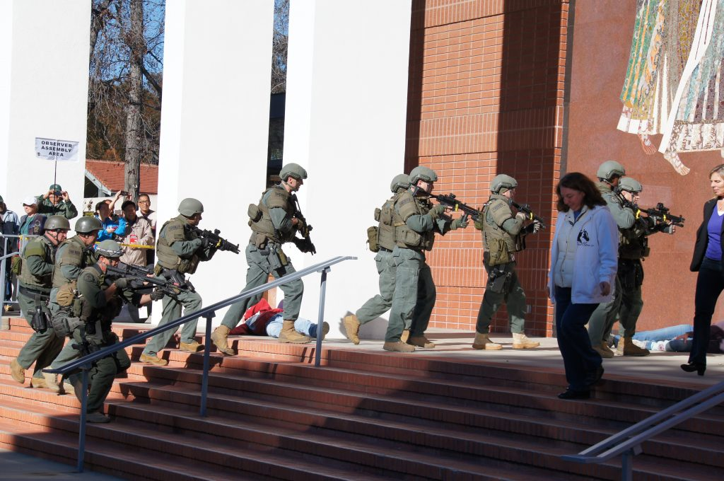 As journalists and campus staff look on, a Los Angeles County Sheriff's Department SWAT team responds to a mock  mass shooting at Scripps College in Claremont. (Photo by Saul Gonzalez)