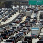 In this May 28, 2010 file photo, the rush hour commute starts in early afternoon and with greater intensity as traffic is jammed in both directions on Interstate 405 on the Westside of Los Angeles as commuters and vacationers hit the road. (AP Photo/Reed Saxon)