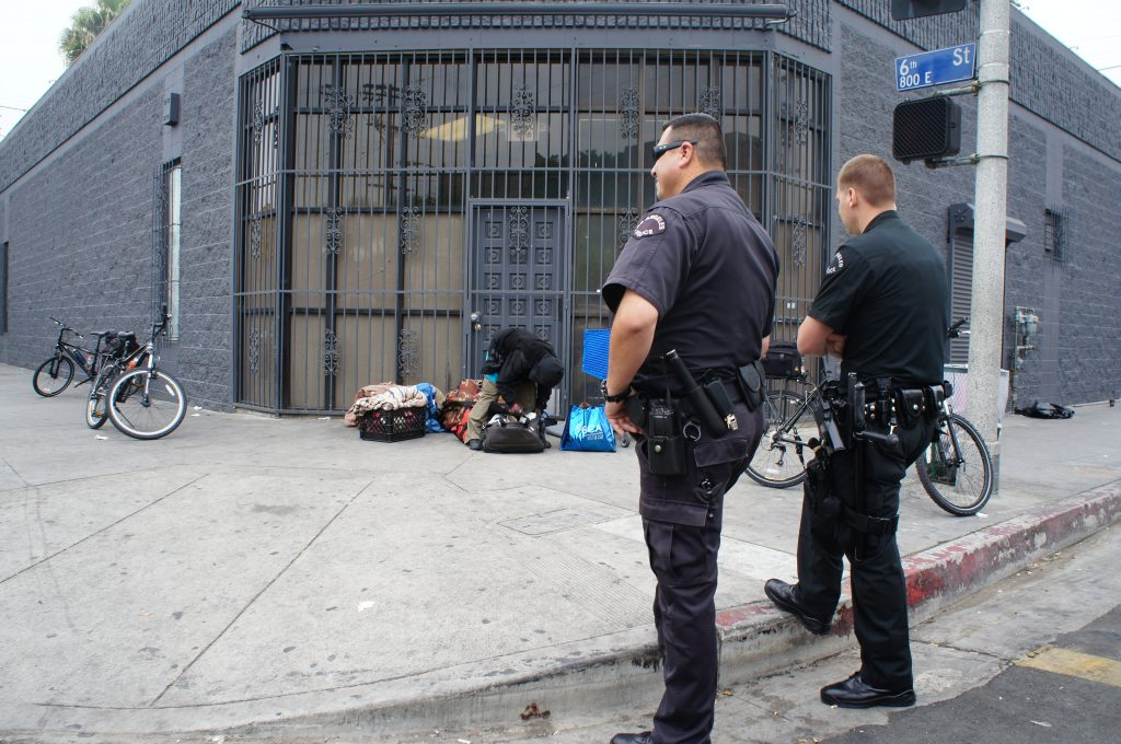 Because of the TB outbreak, the LAPD is recommending that its officers wear face masks and try to avoid close face to face contact when interacting with possilby infecting individuals on skid row.