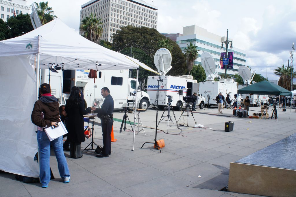 The wall of television trucks and the press encampment in front of the Los Angeles Police Department headquarters this afternoon. The  reporters are waiting for updates about further developments in the hunt for fugitive Christopher Dorner.