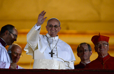 Newly elected Pope Francis, Cardinal Jorge Mario Bergoglio of Argentina appears on the balcony of St. Peter's Basilica after being elected by the conclave of cardinals, at the Vatican, March 13, 2013. White smoke rose from the Sistine Chapel chimney and the bells of St. Peter's Basilica rang out on Wednesday, signaling that Roman Catholic cardinals had elected a pope to succeed Benedict XVI. Photo by Dylan Martinez/Reuters