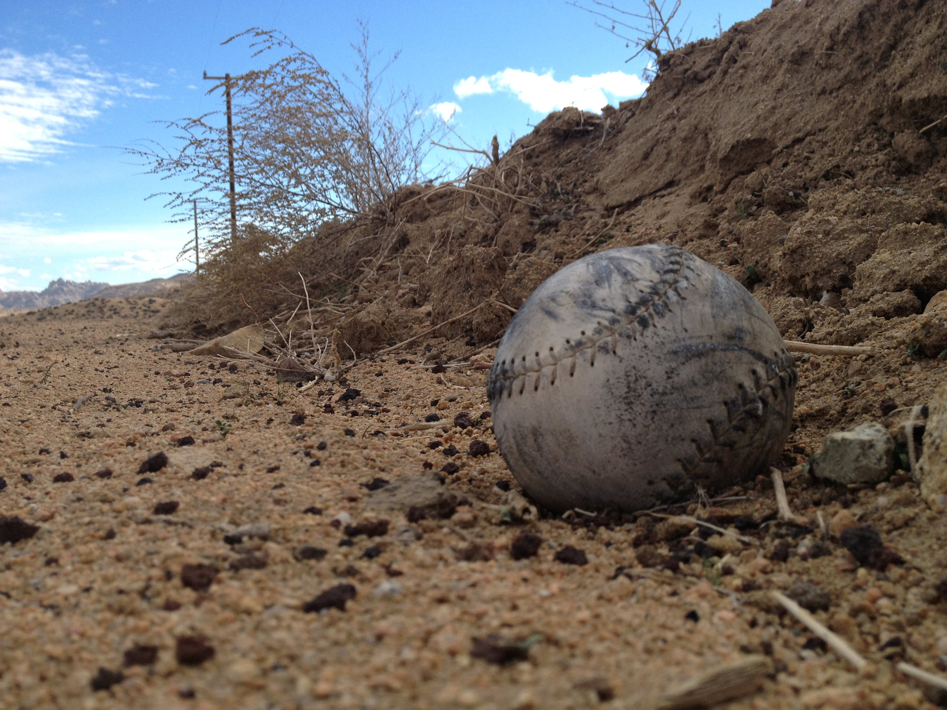 An old baseball in the desert, an example of the objects left behind. Photo by Brian Calvert.